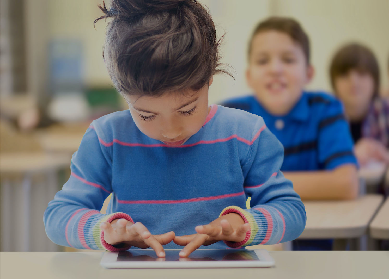 Student In Classroom With IPad